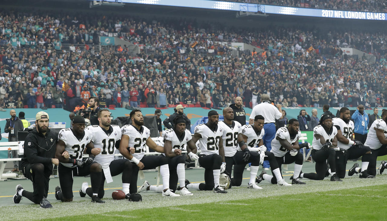 <p>New Orleans Saints players kneel down before the U.S. anthem was played for an NFL football game against the Miami Dolphins at Wembley Stadium in London, Sunday Oct. 1, 2017. (AP Photo/Matt Dunham) </p>
