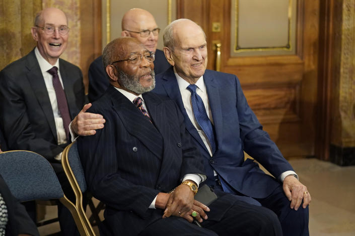 The Rev. Amos C. Brown, front left, and President Russell M. Nelson of The Church of Jesus Christ of Latter-day Saints are shown during a news conference Monday, June 14, 2021, in Salt Lake City. Top leaders from the NAACP and The Church of Jesus Christ of Latter-day Saints announced $9.25 million in new educational and humanitarian projects as they seek to build on an alliance formed in 2018. (AP Photo/Rick Bowmer)