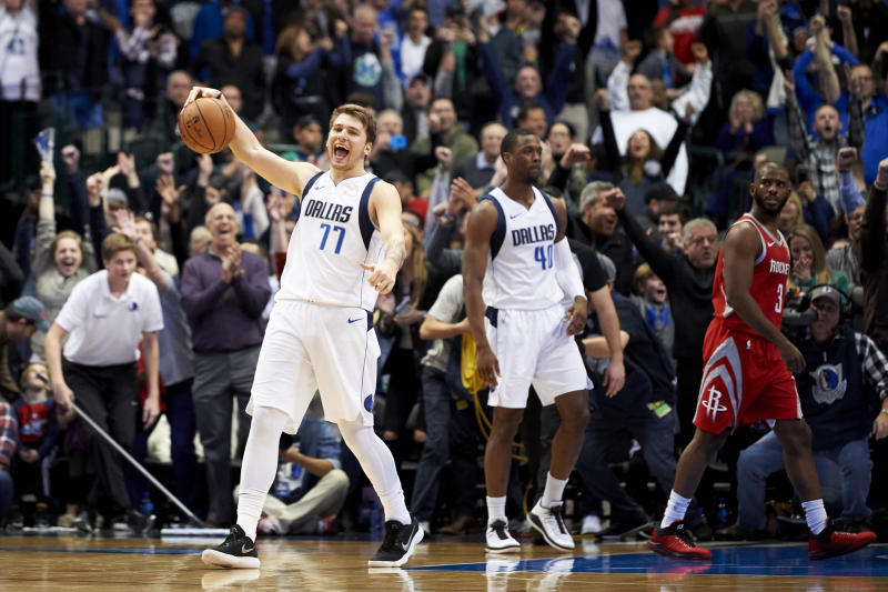 Dallas Mavericks forward Luka Doncic (77) celebrates after the Mavericks defeated the Houston Rockets 107-104 in an NBA basketball game, Saturday, Dec. 8, 2018, in Dallas. (AP Photo/Cooper Neill)