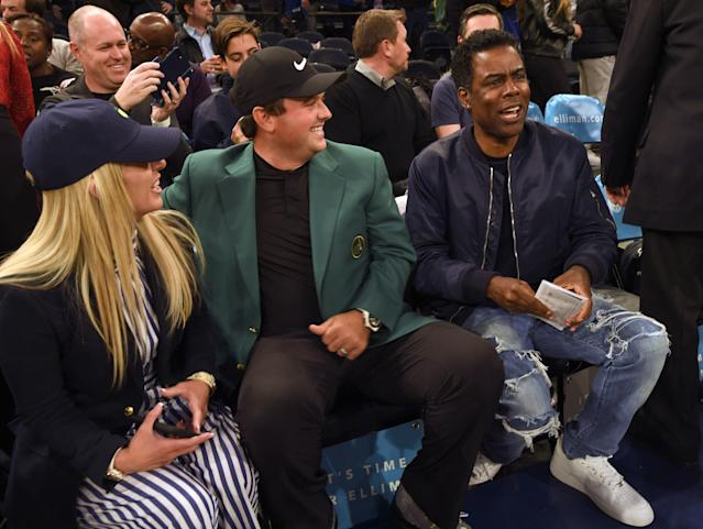 "<div class=""caption""> NEW YORK, NY - APRIL 09: Masters Champion Patrick Reed and his wife Justine are visited by comedian Chris Rock during the New York Knicks and Cleveland Cavaliers basketball game during the Masters winner media tour throughout New York City on April 9, 2018 in New York City, New York. (Photo by Stan Badz/PGA TOUR) </div> <cite class=""credit"">Stan Badz</cite>"