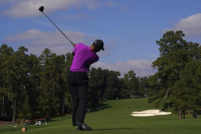 Tiger Woods hits from the eighth tee during the third round of the Masters on Saturday.