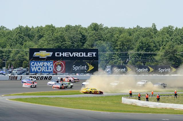 LONG POND, PA - JUNE 10: AJ Allmendinger, driver of the #22 Shell/Pennzoil Dodge, spins through the grass after being involved in an on track incident during the NASCAR Sprint Cup Series Pocono 400 presented by #NASCAR at Pocono Raceway on June 10, 2012 in Long Pond, Pennsylvania. (Photo by Jared C. Tilton/Getty Images)