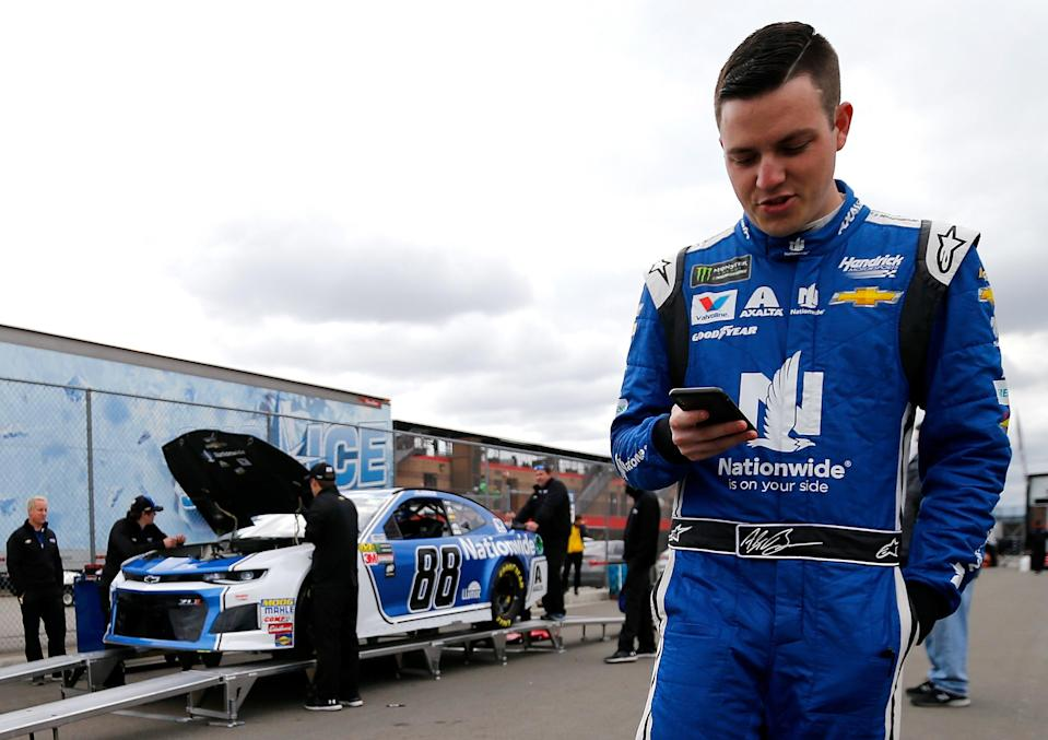 FONTANA, CA – MARCH 16: Alex Bowman, driver of the #88 Nationwide Chevrolet, waits for his car to pass inspection during qualifying for the Monster Energy NASCAR Cup Series Auto Club 400 at Auto Club Speedway on March 16, 2018 in Fontana, California. (Photo by Jonathan Ferrey/Getty Images)