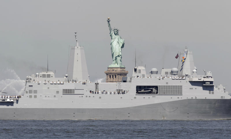 Sailors stand on the deck as the USS New York passes the Statue of Liberty to kick off Fleet Week in New York, Wednesday, May 25, 2011. Fleet Week ends on Memorial Day with a military flyover honoring American military personnel who lost their lives in service.  (AP Photo/Seth Wenig)