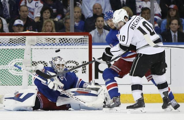New York Rangers goalie Henrik Lundqvist (30) blocks a shot by Los Angeles Kings center Mike Richards (10) as Rangers defenseman Anton Stralman (6) helps defend in the second period during Game 3 of the NHL hockey Stanley Cup Final, Monday, June 9, 2014, in New York. (AP Photo/Kathy Willens)