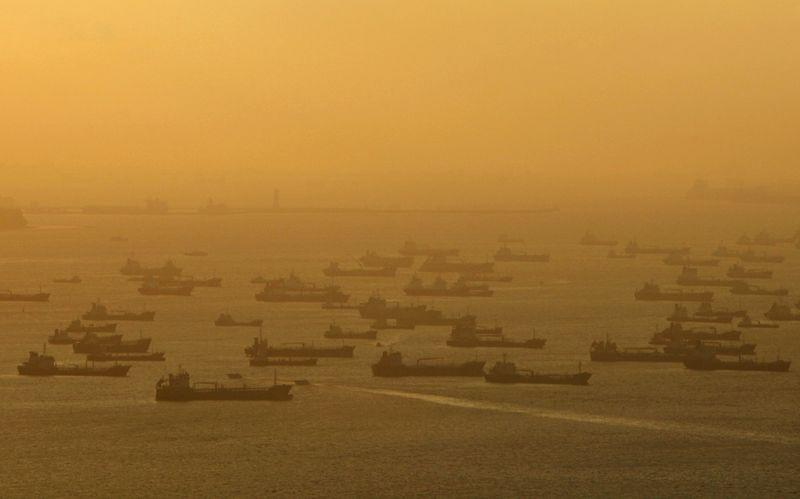 File photo of shipping vessels and oil tankers lining up on the eastern coast of Singapore