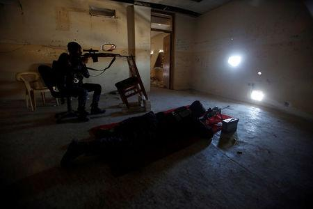 Snipers of the Iraqi federal police take their positions during clashes with Islamic State militants, in Mosul
