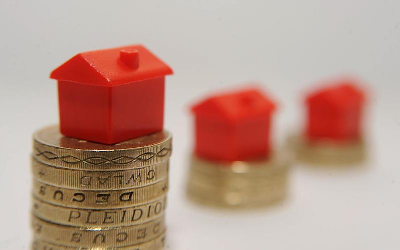 Model houses on pound coins - Credit: Joe Giddens /PA