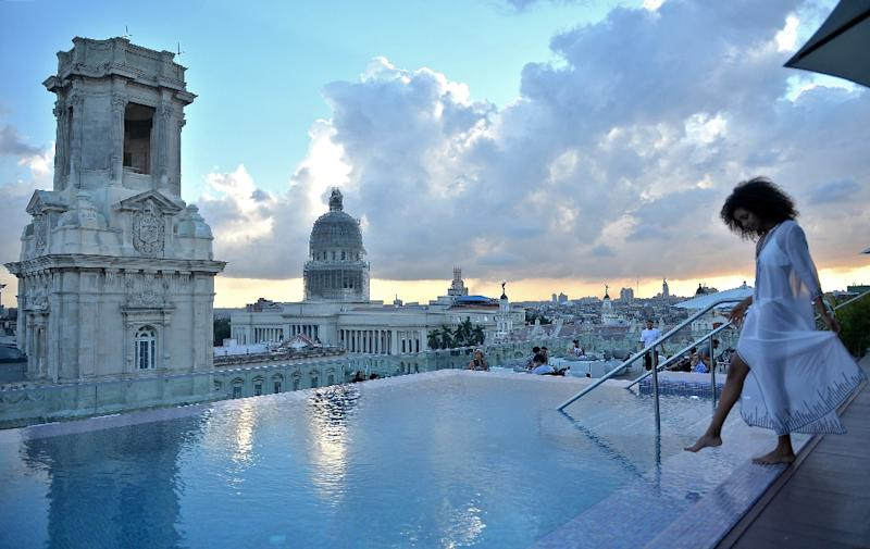 A tourist stands by the rooftop swimming pool at the Gran Hotel Manzana in Havana -- one of many luxury properties attracting tourists in Cuba (AFP Photo/Yamil LAGE)