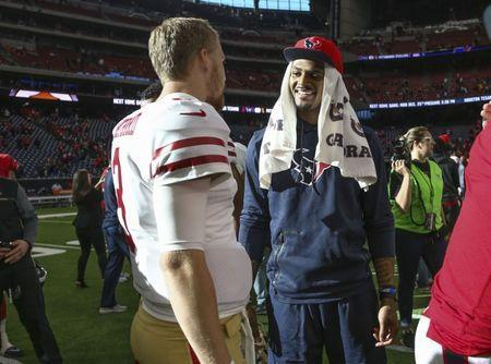 Dec 10, 2017; Houston, TX, USA; Houston Texans quarterback Deshaun Watson (4) talks with San Francisco 49ers quarterback C.J. Beathard (3) after a game at NRG Stadium. Mandatory Credit: Troy Taormina-USA TODAY Sports