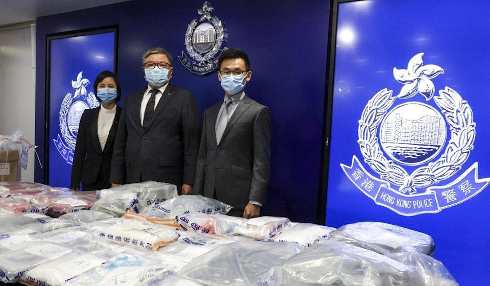 Narcotics bureau Chief Inspector Ip Sau-lan (left) and colleagues display the drugs seized. Photo: K. Y. Cheng