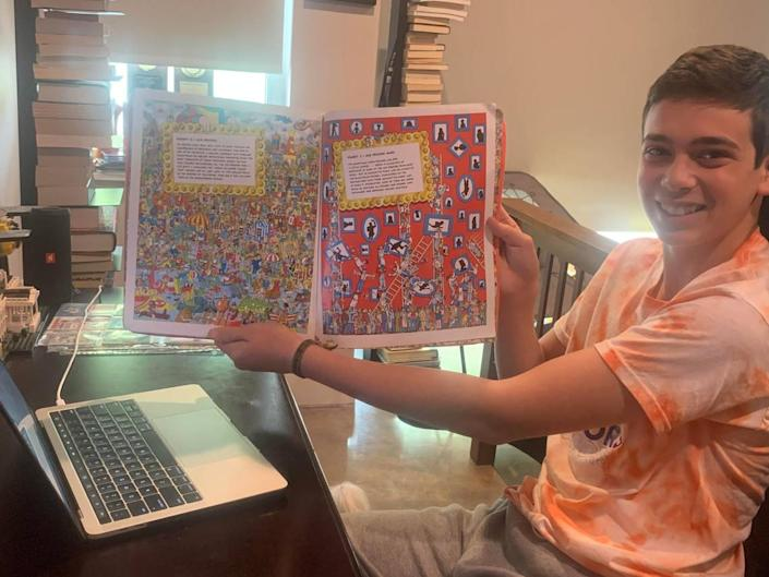 Matthew Lewis, 14, is spending his summer reading to younger kids through the Jewish Community Services and Achieve Miami's buddy program.