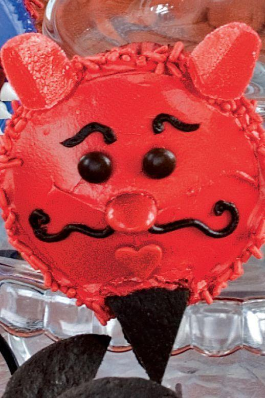 """<p>Red sprinkles, red M&M's, spice drops, and heart candies decorate these devilishly delicious cupcakes.</p><p><strong><em><a href=""""https://www.womansday.com/food-recipes/food-drinks/a28860819/debonair-devil-cupcake-recipe/"""" rel=""""nofollow noopener"""" target=""""_blank"""" data-ylk=""""slk:Get the Debonair Cupcake recipe."""" class=""""link rapid-noclick-resp"""">Get the Debonair Cupcake recipe. </a></em></strong></p>"""