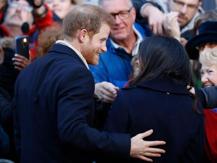 Prince Harry and Meghan Markle visit Nottingham Contemporary. Harry has his arm around Meghan.