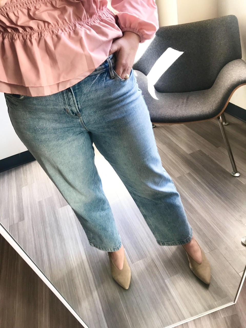 """<p><strong>The item:</strong> <span>Old Navy High-Waisted Light Stone-Washed Slim Wide-Leg Jeans</span> ($40) </p> <p><strong>What our editor said:</strong> """"I slipped them on and they buttoned over my stomach with ease, fitting snugly without squeezing or pinching. I bought a size 12, which is my typical choice for bottoms, so they're true to size. Not only do these jeans fit well, but they're also smoothing and a great cut. They have a bit of elastic in them, which makes the material really comfortable, too. Luckily, even with the built-in stretch, they don't bag out after wearing them all day. The wider leg is cute because it can easily be dressed up or down. I found a winner! I could definitely wear a bodysuit or tucked-in shirt with these jeans and feel amazing."""" - MCW</p> <p>If you want to read more, here is <a href=""""https://www.popsugar.com/fashion/old-navy-jeans-for-women-review-47260507"""" class=""""link rapid-noclick-resp"""" rel=""""nofollow noopener"""" target=""""_blank"""" data-ylk=""""slk:the complete review"""">the complete review</a>.</p>"""