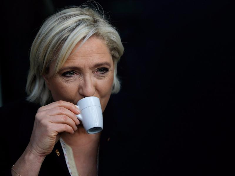 Marine Le Pen, French National Front (FN) political party leader and candidate for French 2017 presidential election, drinks a coffee after a visit to a market in Concarneau.