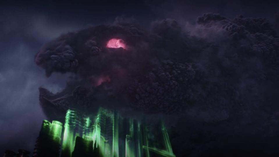 A giant purple cloud monster with red eyes and a mouth forming over the green outline of buildinds