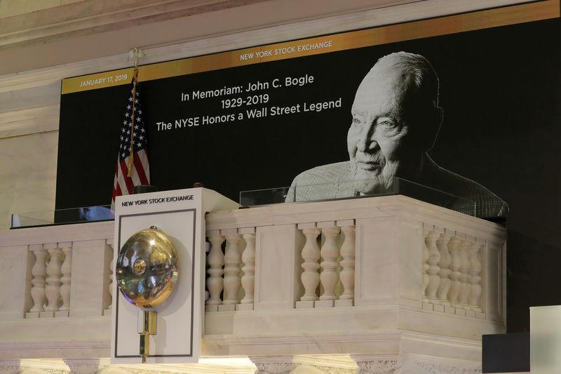FILE PHOTO: A tribute to Jack Bogle, founder and retired CEO of The Vanguard Group, is displayed on the bell balcony over the trading floor of the NYSE in New York