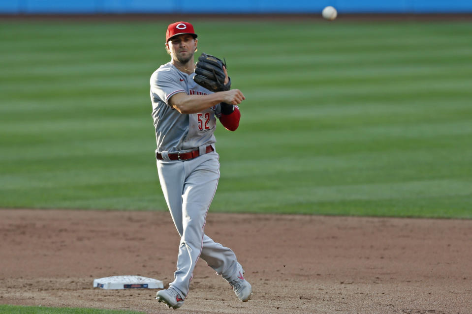 Cincinnati Reds' Kyle Farmer throws out Cleveland Indians' Beau Taylor during the fifth inning of a baseball game at Progressive Field, Thursday, Aug. 6, 2020, in Cleveland. (AP Photo/David Dermer)