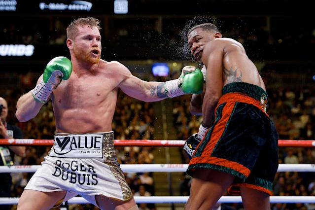 Canelo Alvarez hits Daniel Jacobs during a middleweight title boxing match Saturday, May 4, 2019, in Las Vegas. (AP Photo/John Locher)