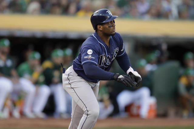 Tampa Bay Rays' Yandy Diaz watches the flight of his solo home run against the Oakland Athletics during the first inning of an American League wild-card baseball game in Oakland, Calif., Wednesday, Oct. 2, 2019. (AP Photo/Ben Margot)