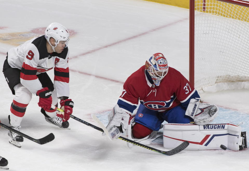 New Jersey Devils' Taylor Hall moves in on Montreal Canadiens goaltender Keith Kinkaid during the third period of an NHL hockey game in Montreal, Saturday, Nov. 16, 2019. (Graham Hughes/The Canadian Press via AP)