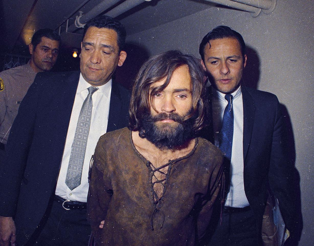 <p>Charles Manson is escorted to his arraignment on conspiracy-murder charges in connection with the Sharon Tate murder case, 1969, in Los Angeles. (Photo: AP) </p>