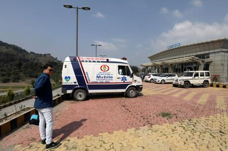 An ambulance is parked outside an airport where the bodies of missing climbers are expected to arrive in Pithoragarh