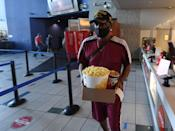 <p>John Gray of Nevada gets snacks at a concession stand at AMC Town Square 18 on August 20 in Las Vegas, Nevada.</p>