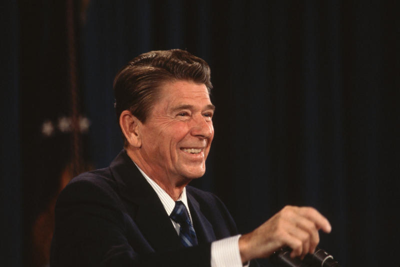 President Ronald Reagan smiles while fielding questions during a White House press conference.