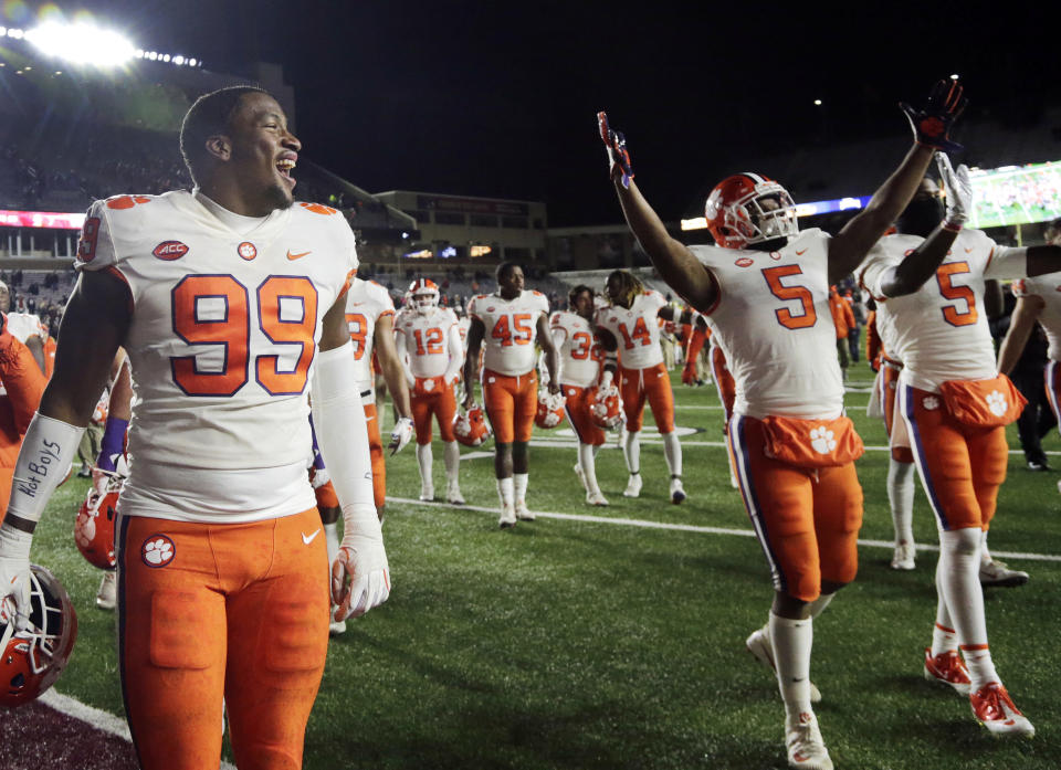 Clemson defensive end Clelin Ferrell (99) and teammates celebrate their 27-7 victory over Boston College after an NCAA college football game, Saturday, Nov. 10, 2018, in Boston. (AP Photo/Elise Amendola)