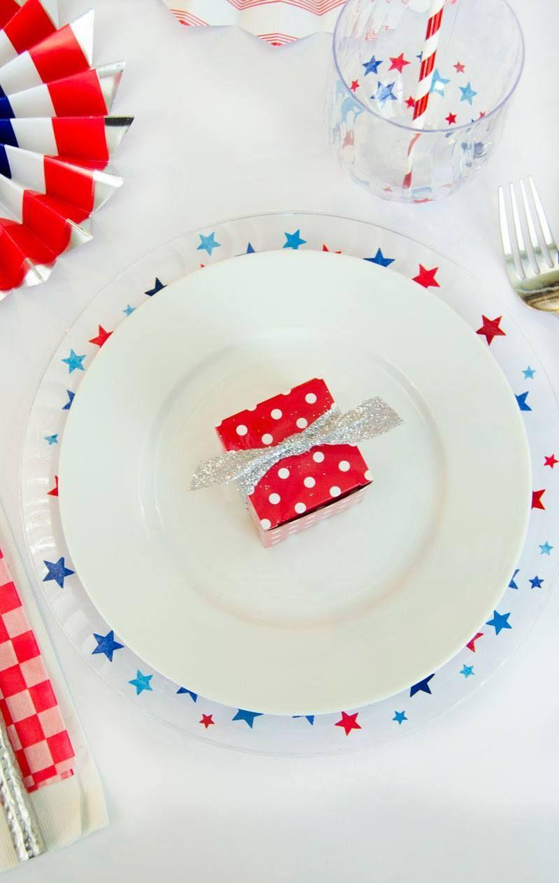 """<p>While you're in the crafting mood, use some star-shaped confetti and some glue to take plain disposable dinnerware from drab to fab. </p><p><a class=""""link rapid-noclick-resp"""" href=""""https://love-the-day.com/4th-july-table-decorations"""" rel=""""nofollow noopener"""" target=""""_blank"""" data-ylk=""""slk:GET THE TUTORIAL"""">GET THE TUTORIAL</a></p><p><a class=""""link rapid-noclick-resp"""" href=""""https://www.amazon.com/Silver-Confetti-Table-Metallic-Stars/dp/B07S3LWY3H/ref=sr_1_9?dchild=1&keywords=star+confetti&qid=1591632159&sr=8-9&tag=syn-yahoo-20&ascsubtag=%5Bartid%7C10072.g.32715018%5Bsrc%7Cyahoo-us"""" rel=""""nofollow noopener"""" target=""""_blank"""" data-ylk=""""slk:SHOP CONFETTI"""">SHOP CONFETTI</a></p>"""