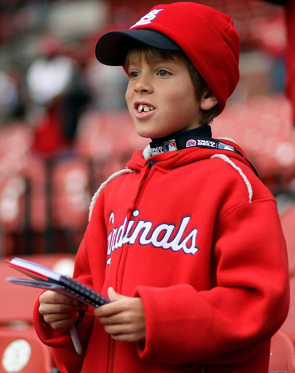 ST LOUIS, MO - OCTOBER 19: A young fan of the St. Louis Cardinals gets ready for during Game One of the MLB World Series between the Texas Rangers and the St. Louis Cardinals at Busch Stadium on October 19, 2011 in St Louis, Missouri. (Photo by Ezra Shaw/Getty Images)