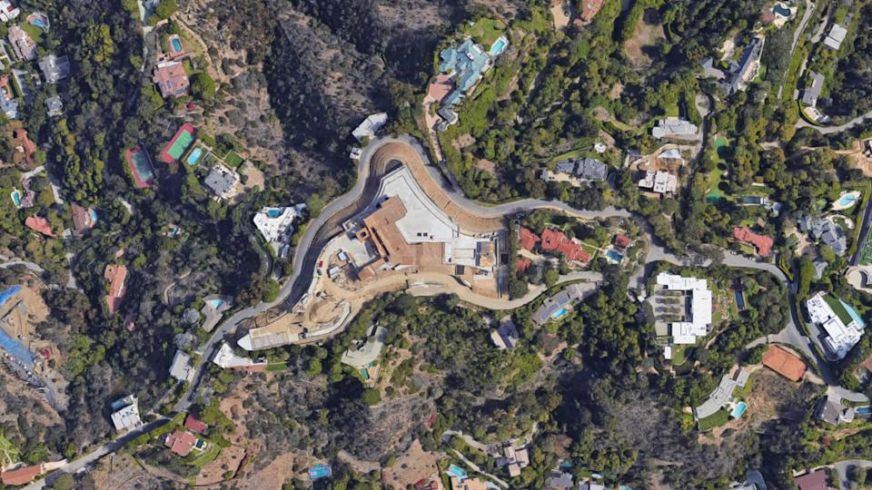 """<ul> <li><strong>Cost: </strong>$97.75 million</li> </ul> <p>When you're one of the biggest and richest musical stars in the world, locking down just one mortgage for a luxury mansion simply won't cut it. That's why Bey has three <a href=""""https://www.gobankingrates.com/investing/real-estate/what-5-million-dollar-home-looks-like-us/?utm_campaign=1023534&utm_source=yahoo.com&utm_content=20"""" rel=""""nofollow noopener"""" target=""""_blank"""" data-ylk=""""slk:multimillion-dollar homes"""" class=""""link rapid-noclick-resp"""">multimillion-dollar homes</a>: a $2.9 million five-bedroom cottage-style East Hampton mansion, a $6.85 million penthouse in lower Manhattan and an $88 million multistructure compound in Bel Air, Variety reports.</p> <p>The Bel Air estate has eight bedrooms, 11 bathrooms, four outdoor pools, a spa and wellness center, a basketball court and enough garage space for 15 cars. Property taxes for this property alone totaled $1.05 million per year as of 2019, according to the Los Angeles Times.</p>"""