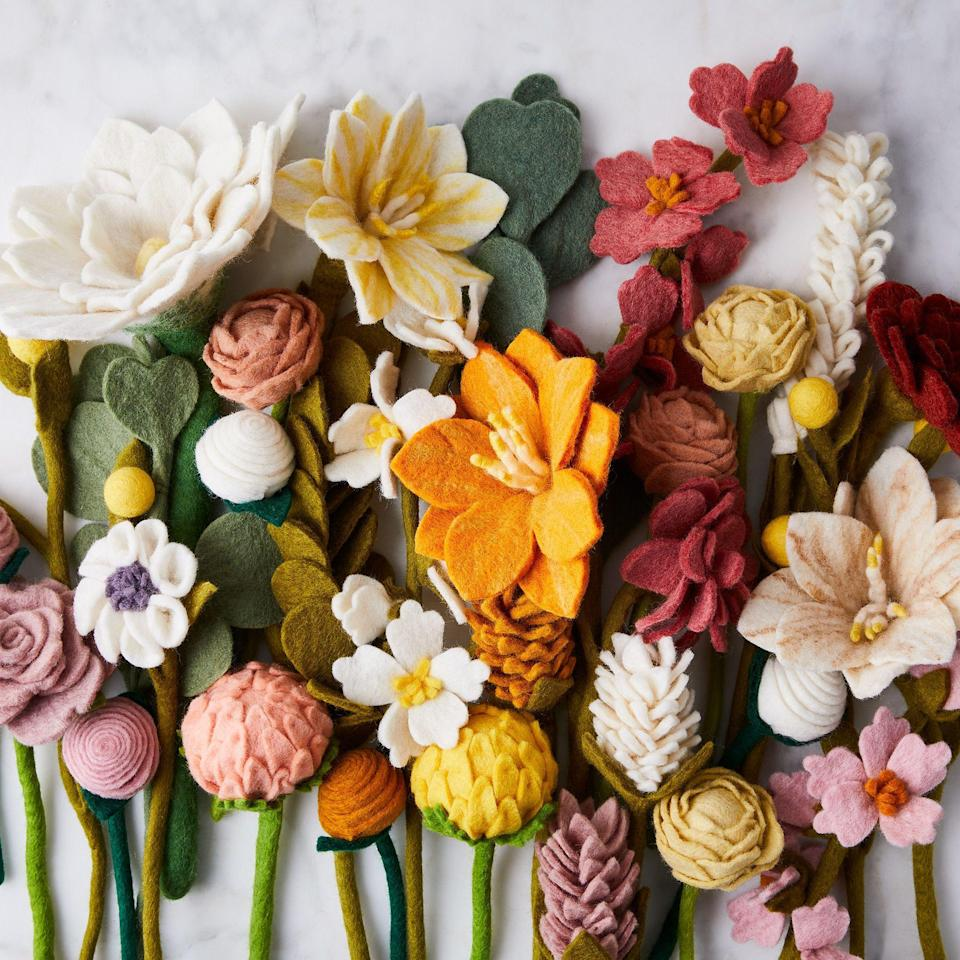 """<h2>Global Goods Partners Handmade Felt Daisy<br></h2><br>A daisy is just one of the flowers to choose from in Food52's array of sweet felted flora — a pretty present that will deliver daily cheer as it lives in perpetuity on your best pal's windowsill.<br><br><em>Shop </em><strong><a href=""""https://food52.com/"""" rel=""""nofollow noopener"""" target=""""_blank"""" data-ylk=""""slk:Food52"""" class=""""link rapid-noclick-resp""""><em>Food52</em></a></strong><br><br><strong>Global Goods Partners</strong> Handmade Felt Daisy, $, available at <a href=""""https://go.skimresources.com/?id=30283X879131&url=https%3A%2F%2Ffood52.com%2Fshop%2Fproducts%2F7175-handmade-felt-flower-eucalyptus-bouquets"""" rel=""""nofollow noopener"""" target=""""_blank"""" data-ylk=""""slk:Food52"""" class=""""link rapid-noclick-resp"""">Food52</a>"""