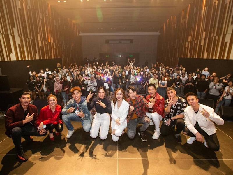 """The performers taking a photo with their crowd of fans at the recently-held """"The Singing Pizza Concert""""."""