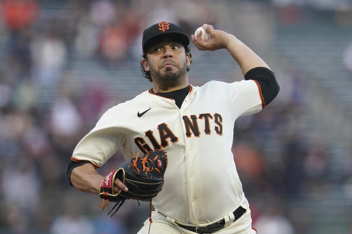 San Francisco Giants' Jose Alvarez pitches against the Milwaukee Brewers during the first inning of a baseball game in San Francisco, Monday, Aug. 30, 2021. (AP Photo/Jeff Chiu)