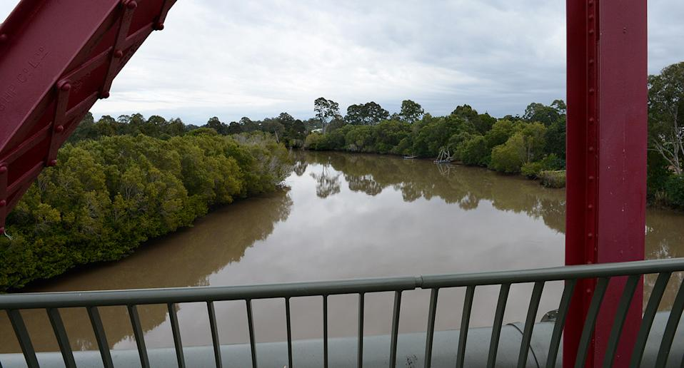 The scene of the Logan River from a bridge at Eagleby, south of Brisbane, Monday, June 25, 2012, where a 7-month-old baby boy was alledgely killed by his father on Saturday after the pair fell into the river. The baby's 38-year-old father has been charged with his murder. (AAP Image/Dave Hunt) NO ARCHIVING