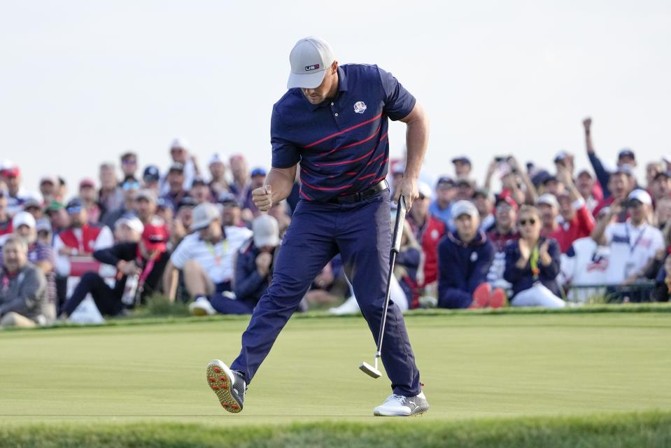 Team USA's Bryson DeChambeau reacts after making a putt on the 15th hole during a four-ball match the Ryder Cup at the Whistling Straits Golf Course Friday, Sept. 24, 2021, in Sheboygan, Wis. (AP Photo/Jeff Roberson)