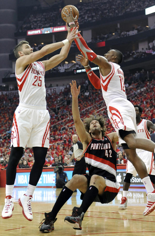 Houston Rockets Chandler Parsons (25) and Dwight Howard (12) grab a rebound over a falling Portland Trail Blazers' Robin Lopez (42) in the first half of Game 5 of an opening-round NBA basketball playoff series Wednesday, April 30, 2014, in Houston. (AP Photo/Pat Sullivan)