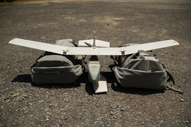 This US Marine Corps handout photo shows an Unmanned Aircraft System Raven drone laying on the ground shortly before being launched into the air to provide overwatch of friendly forces, July 12, 2014, on the Hawaiian island of Oahu (AFP Photo/Cpl. Matthew Bragg)