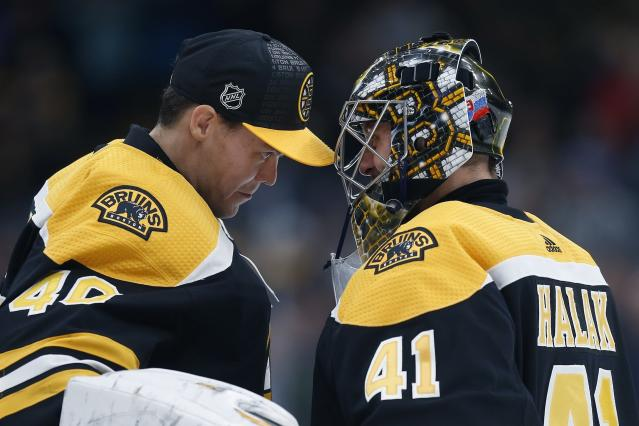 FILE - In this Thursday, Oct. 25, 2018, file photo, Boston Bruins' Jaroslav Halak (41) celebrates with Tuukka Rask after defeating the Philadelphia Flyers during an NHL hockey game in Boston. Managing top goaltenders schedules is the NHLs version of load management. Each of the past five Stanley Cup-winning goalies started fewer than 60 games in the regular season, along with three of the past five runners up. (AP Photo/Michael Dwyer, File)