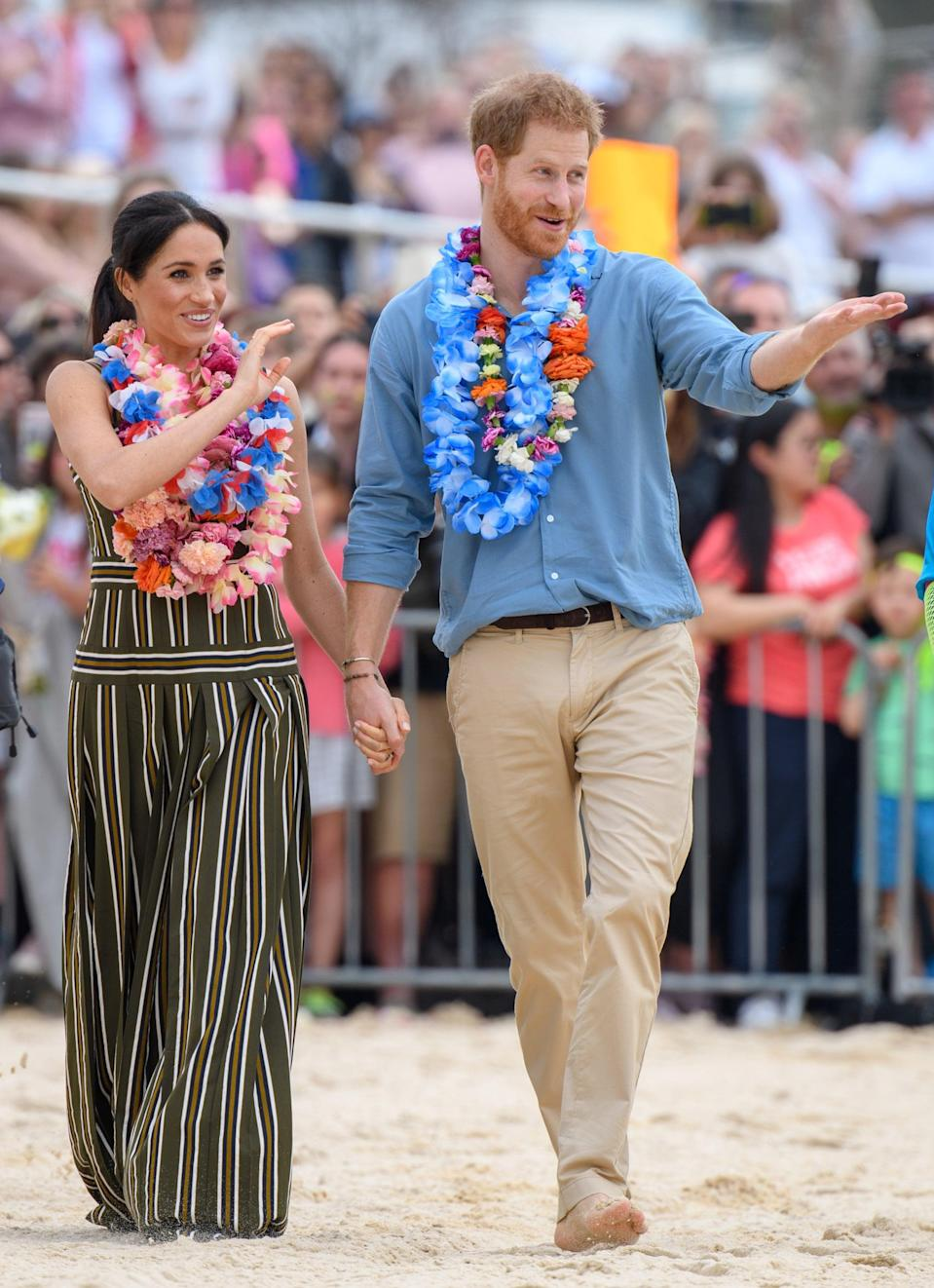 """<p>Meghan chose to wear this <a href=""""https://www.popsugar.com/fashion/Meghan-Markle-Martin-Grant-Dress-Australia-October-2018-45398045"""" class=""""link rapid-noclick-resp"""" rel=""""nofollow noopener"""" target=""""_blank"""" data-ylk=""""slk:casual striped maxi dress by Martin Grant"""">casual striped maxi dress by Martin Grant</a> to visit Bondi Beach in Sydney during their royal tour of Australia, Fiji, Tonga, and New Zealand in October 2018. </p>"""