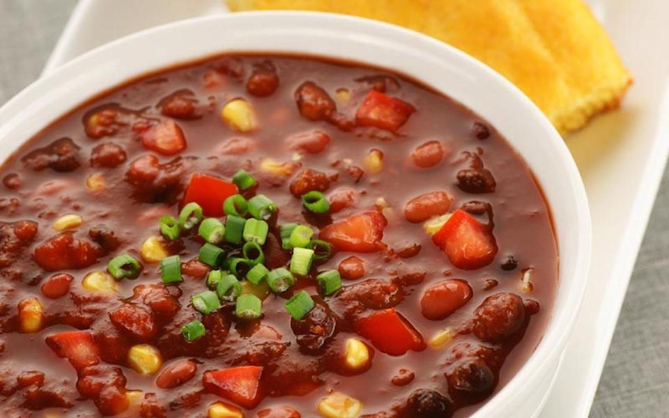 """<p>Here, kidney beans team up with black and Great Northern beans for a chili trifecta. Add minced garlic, diced onion, cumin, tomatoes, peppers and, yes, corn for a fully loaded <a href=""""https://www.thedailymeal.com/cook/50-vegetarian-recipes-meatless-mondays-or-any-other-time-slideshow?referrer=yahoo&category=beauty_food&include_utm=1&utm_medium=referral&utm_source=yahoo&utm_campaign=feed"""" rel=""""nofollow noopener"""" target=""""_blank"""" data-ylk=""""slk:cheap and easy meatless dinner"""" class=""""link rapid-noclick-resp"""">cheap and easy meatless dinner</a>. </p> <p><strong><a href=""""https://www.thedailymeal.com/recipes/three-bean-chili-recipe-0?referrer=yahoo&category=beauty_food&include_utm=1&utm_medium=referral&utm_source=yahoo&utm_campaign=feed"""" rel=""""nofollow noopener"""" target=""""_blank"""" data-ylk=""""slk:For the Three Bean Chili recipe, click here."""" class=""""link rapid-noclick-resp"""">For the Three Bean Chili recipe, click here.</a></strong></p>"""