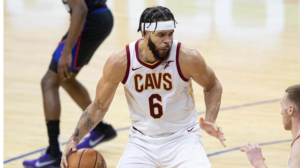 JaVale McGee dribbles the ball with Cavs close crop