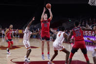Arizona forward Azuolas Tubelis (10) shoots against Southern California during the first half of an NCAA college basketball game Saturday, Feb. 20, 2021, in Los Angeles. (AP Photo/Marcio Jose Sanchez)
