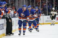 New York Islanders' Mathew Barzal (13) celebrates with teammates after scoring a goal during the third period of Game 4 during an NHL hockey second-round playoff series against the Boston Bruins, Saturday, June 5, 2021, in Uniondale, N.Y. (AP Photo/Frank Franklin II)