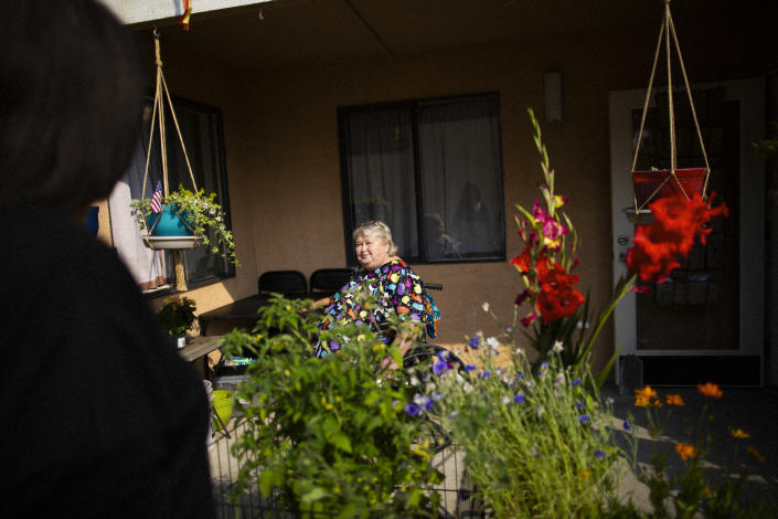 Rosemary Dyer sits on her patio at Home Free, the transitional housing complex where she has lived since her sentence for killing her abusive husband was commuted, on Treasure Island in San Francisco, August 27, 2021. (Talia Herman/The New York Times)