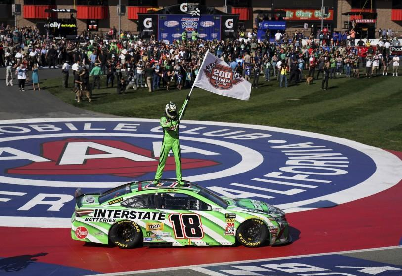 Kyle Buschs stands on his car after winning the NASCAR Cup Series race at Auto Club Speedway in Fontana on March 17, 2019.