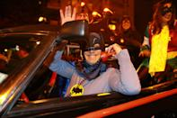 <p>Batman answers the phone while driving the Batmobile in the 44th annual Village Halloween Parade in New York City on Oct. 31, 2017. (Photo: Gordon Donovan/Yahoo News) </p>